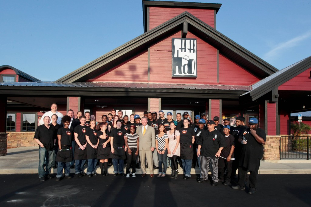 Mayor Buddy Dyer and Commissioner Samuel B. Ings with the staff at Hash House A Go Go