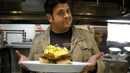 Adam Richman of the Travel Channel's Man Vs. Food with the Fried Chicken Eggs Benedict