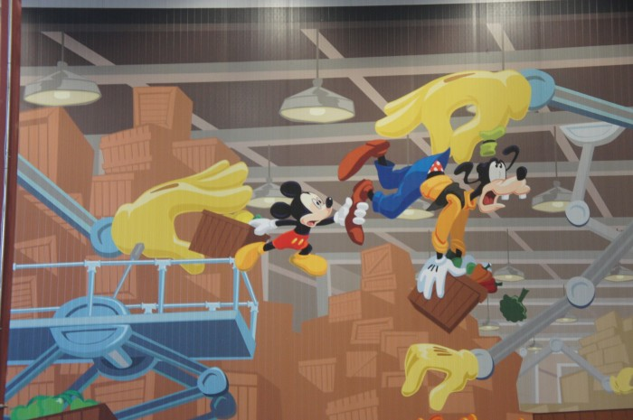 Disney Imagineers paint this scene w Mickey and Goofy at Second Harvest Food Bank