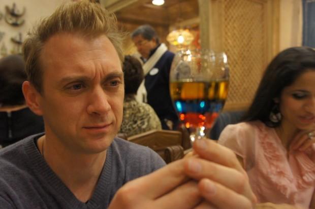Fox 35's David Martin appreciates the colorful drinks at Spice Road Table