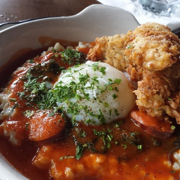 @dkhuang10 Crispy oysters and sausage over rice pirloo topped with a coddled egg in a tomato gravy. #casknlarder #winter parkeats #orlandoeats #oysters @tastychomps #brunch
