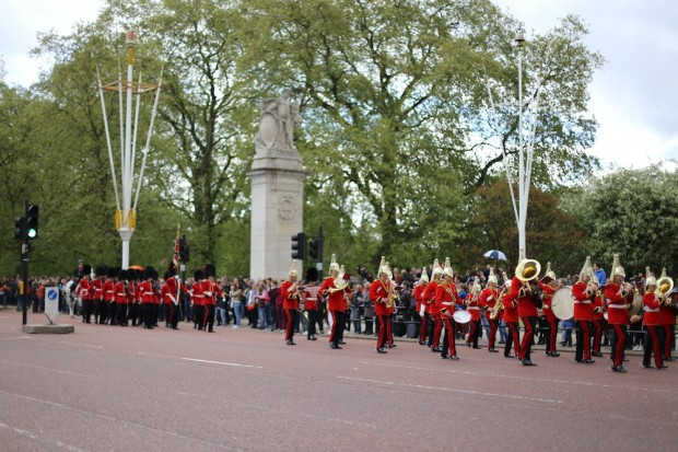 A troop marches down the way with band in tow for The Changing of the Guard at Buckingham Palace
