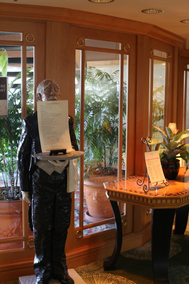 An old fashioned Italian waiter statue greets guests in the front of Hemisphere