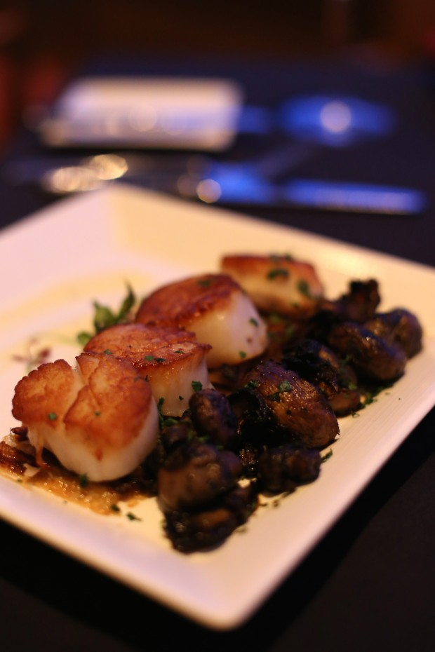 Scallops, fresh from New England, seared, caramelized onion tart, roasted wild mushrooms, garlic cream - $32