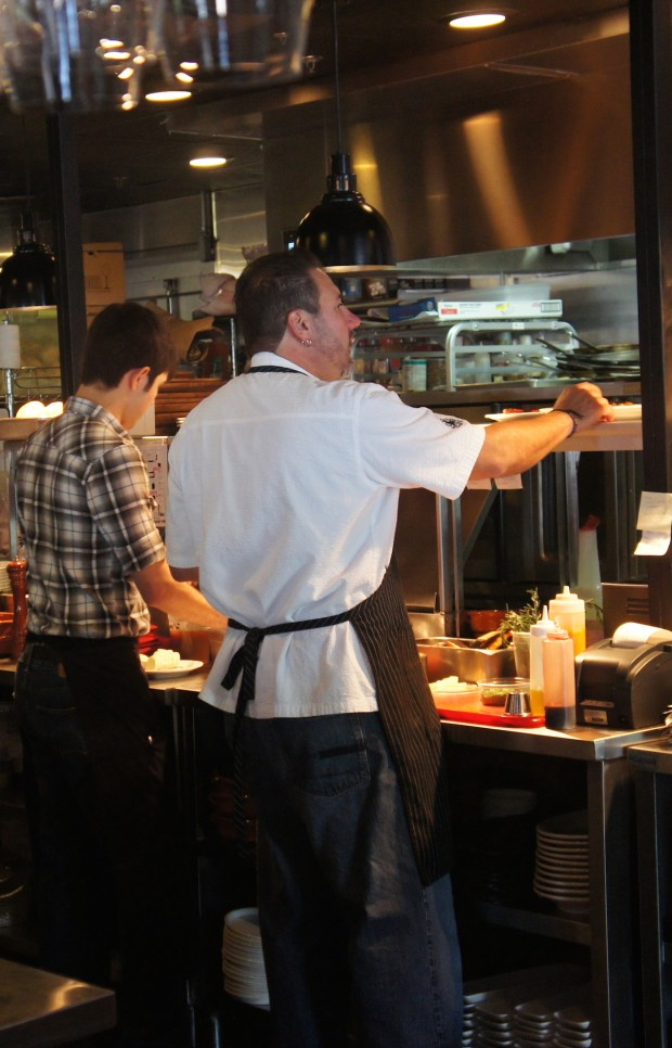 Chef Henry Salgado working the kitchen at Txokos