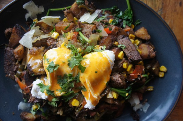 Huevos Ahoghada con Shortribs ($13) - Poached eggs on shortribs and poblano hash, salsa verde, corn, spinach, manchego
