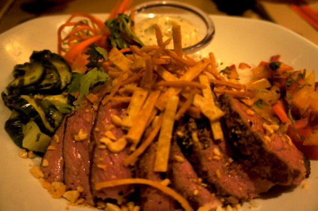 Seared NY Strip Bowl – USDA Choice NY Strip seared to your preference served with marinated cucumbers, roasted peanuts and passion fruit salsa, jasmine rice and a black pepper aioli