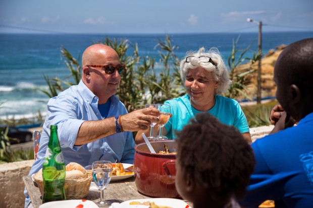 Andrew Zimmern and Mena-Almeida dine at her home overlooking the Atlantic Ocean in Sao Lourenco near Lisbon