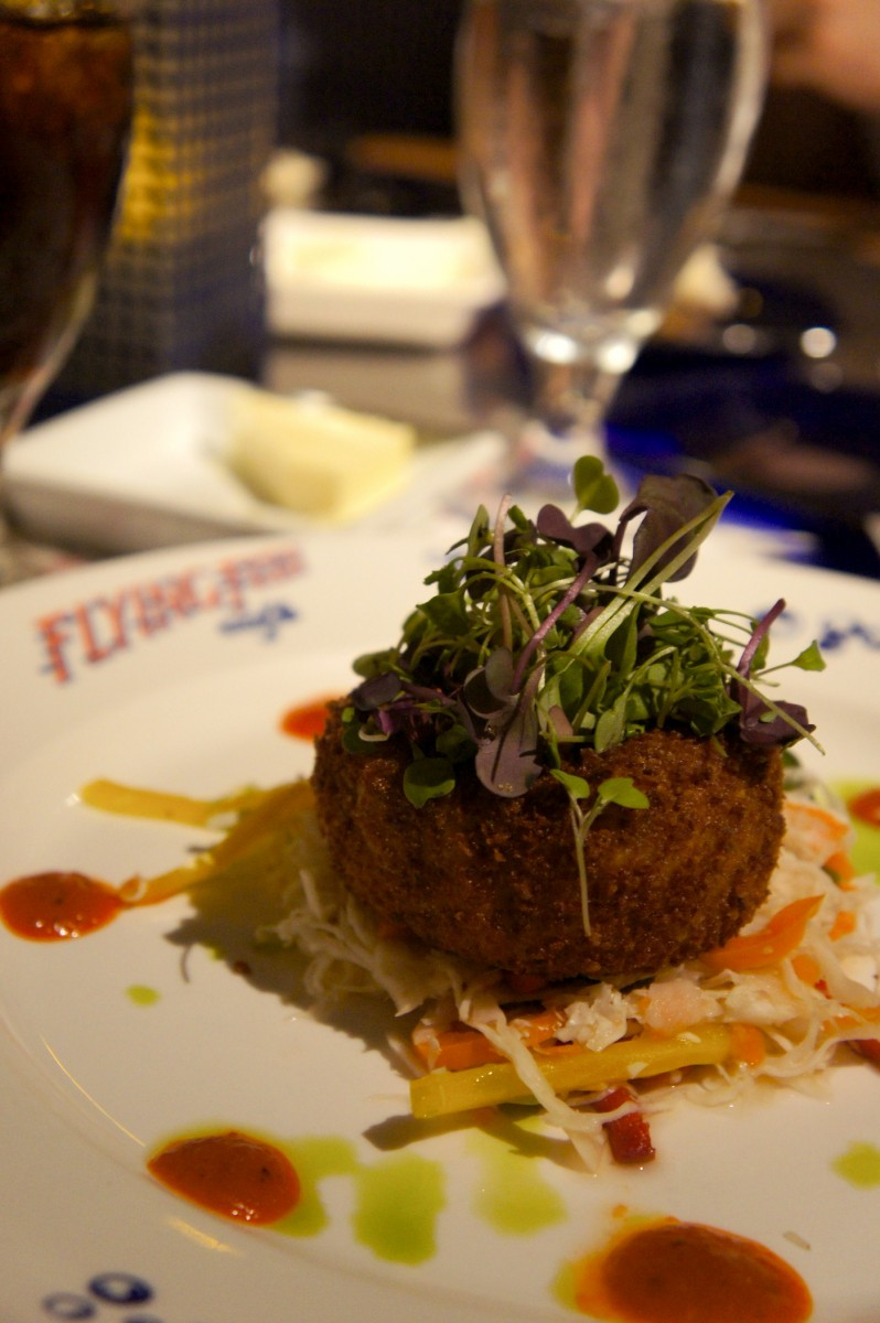 Crispy Maine Coast Jonah Crab Cake - Savory Vegetable Slaw, Roasted Red Pepper Coulis, and Ancho Chile Rémoulade - $17.00