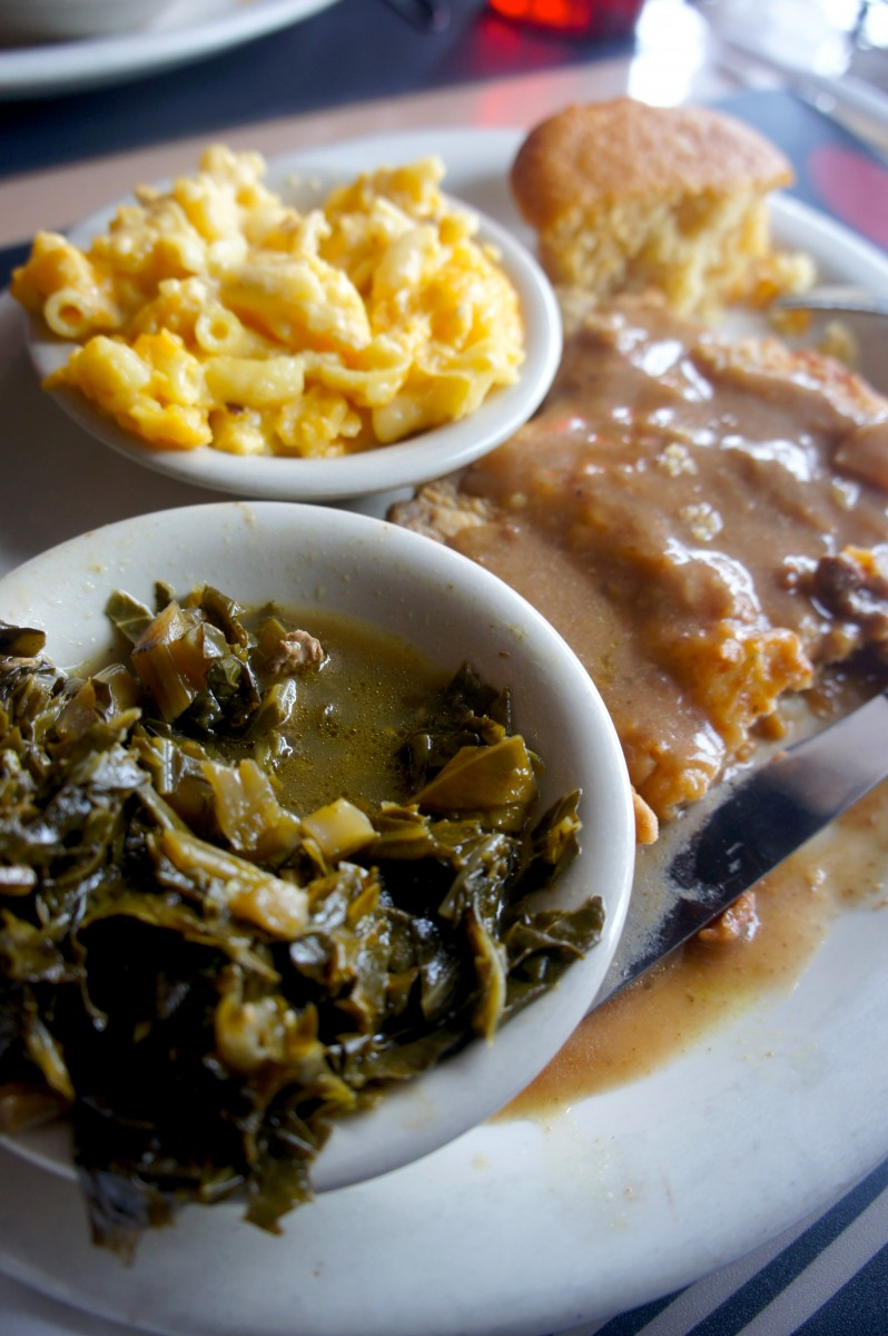 Smothered Pork Chop with mac and cheese and collard greens