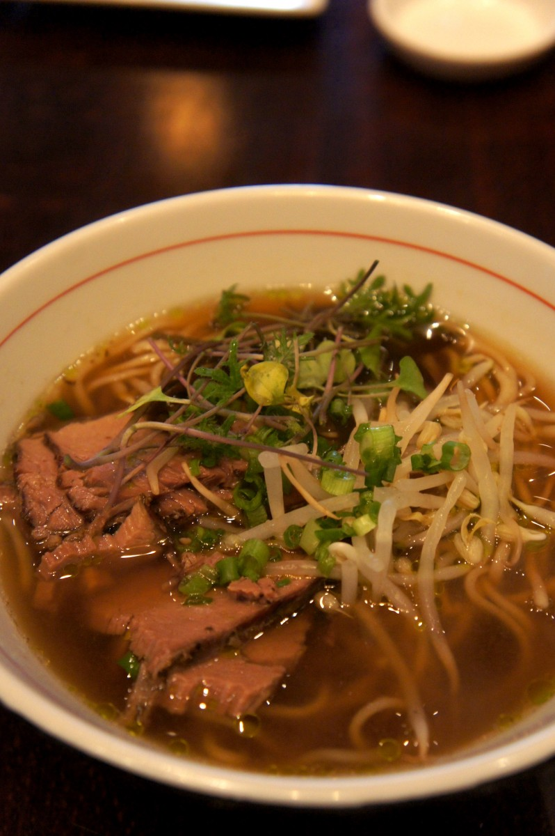 The gyu ramen, beef pho based broth with cilantro oil, beef brisket, and sprouts