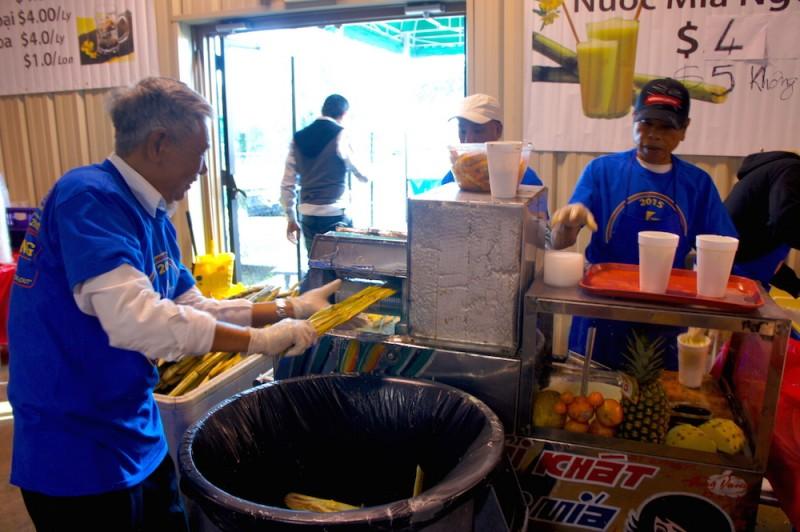 Grinding sugarcane to make sugarcane juice
