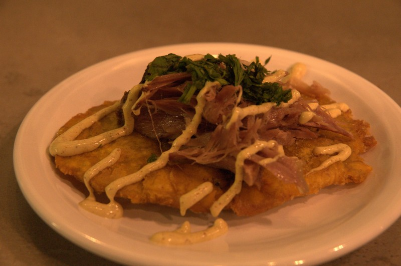 Tostones topped with Pernil