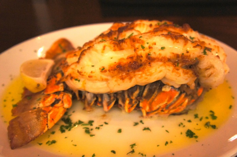 Broiled Lobster Tail Carved tableside & served with drawn butter & lemon.