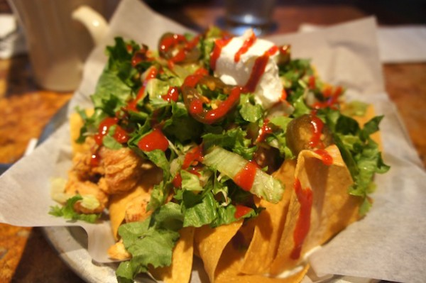 GOGI NACHOS choice of chicken, beef, pork, OR  tofu with jack cheese, jalapenos, tako salad, sour  cream, red sauce