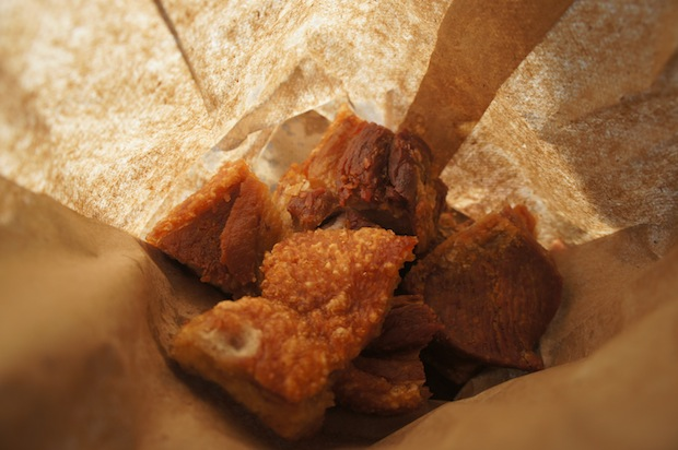 Chicharrones - fried pork skin - in a paper bag from El Palacio de los Jugos. Super cheap street food.