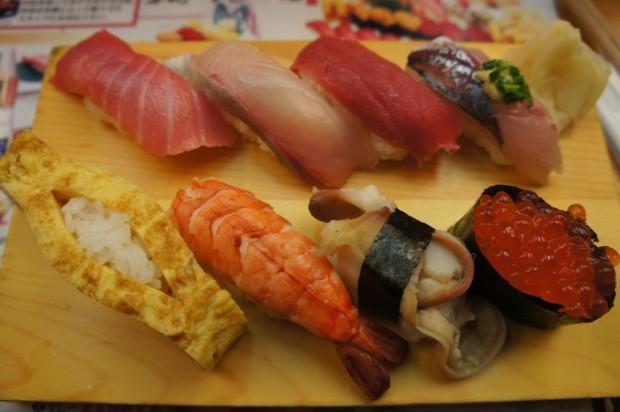 Nigiri sushi plate outside of Tsukiji Fish Market in Tokyo, Japan