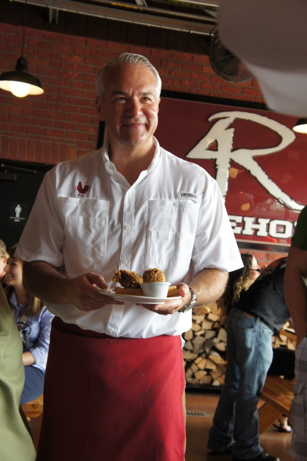 Chef John Rivers presenting the Coop's Chicken and Waffles