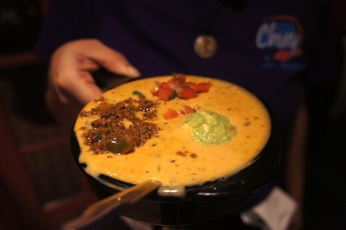 Queso Compuesto $6.99 - filled to the brim Chile Con Queso topped with a satisfying trio of seasoned ground sirloin, guacamole, and pico de gallo