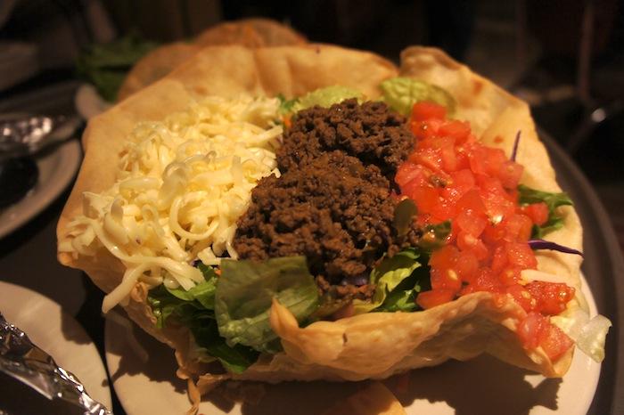 Taco Salad $8.99 - Homemade tortilla bowl with fresh, mixed salad  greens, tomatoes, cheese, guacamole & your choice  of fajita chicken, fajita beef or seasoned ground sirloin