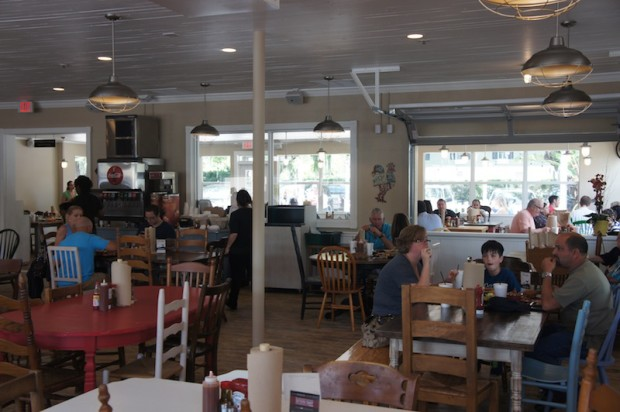 Interior of The Coop - mismatched chairs and tables, family settings...