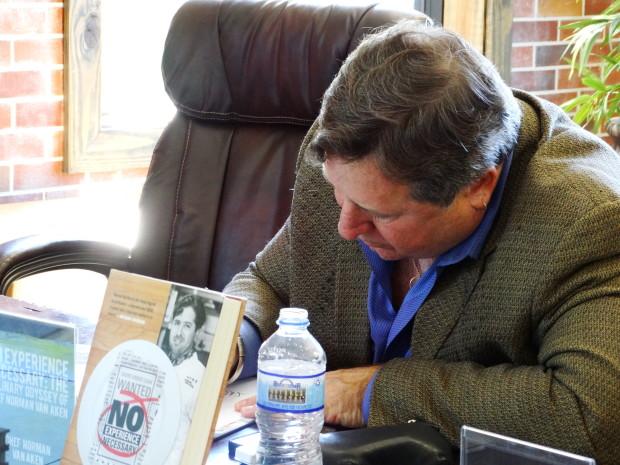 Norman Van Aken  signing his book