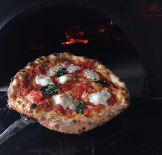 The Margherita Pizza - classic fresh mozzarella, red sauce and fresh basil.
