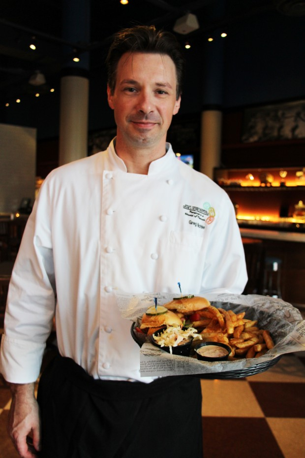 CityFish Executive Chef Greg Richie with the Cornmeal Crisped Shrimp Po Boy - Photo by Unique Michael