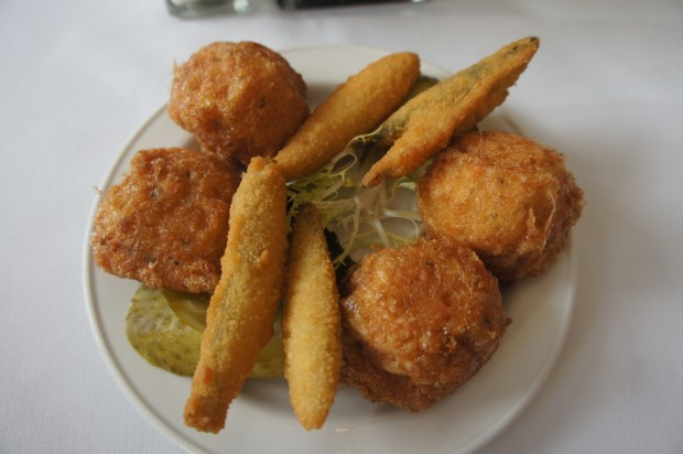 Fried and battered fish hush puppies and anchovies