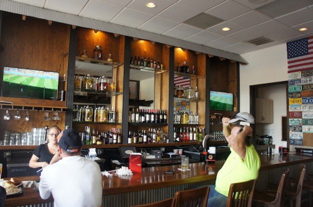 Expansive Bar area to the left of the restaurant's main dining area