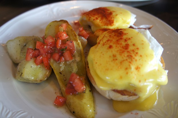 Benedict Lomo - pan de gallego, tomato relish, lomo ham, poached local egg, saffron hollandaise, and charred vegetables - $12