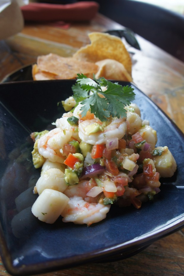 """Ceviche Del Dia"" is made Fresh daily with Marinated seafood with lime, onion, tomato, cilantro, avocado and pepper"