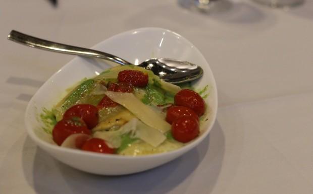 WILD MUSHROOM RAVIOLI  Basil sauce, local cherry tomato confit, shaved parmesan