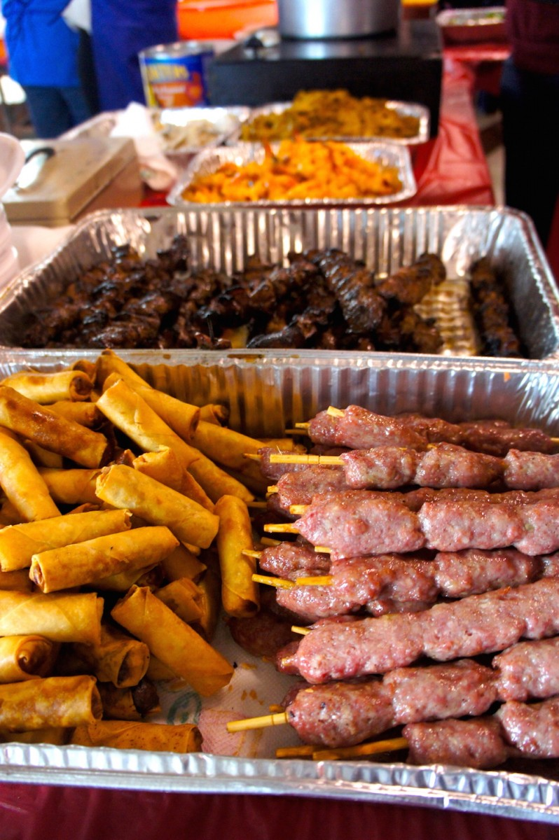 Fried Eggrolls and pork sausage meatballs on a stick