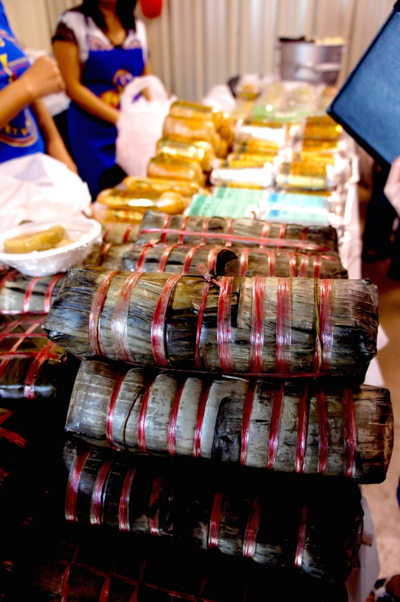 Rolls of banh tet, kind of like Christmas yuletide logs, but with sticky rice and beans to celebrate the new year