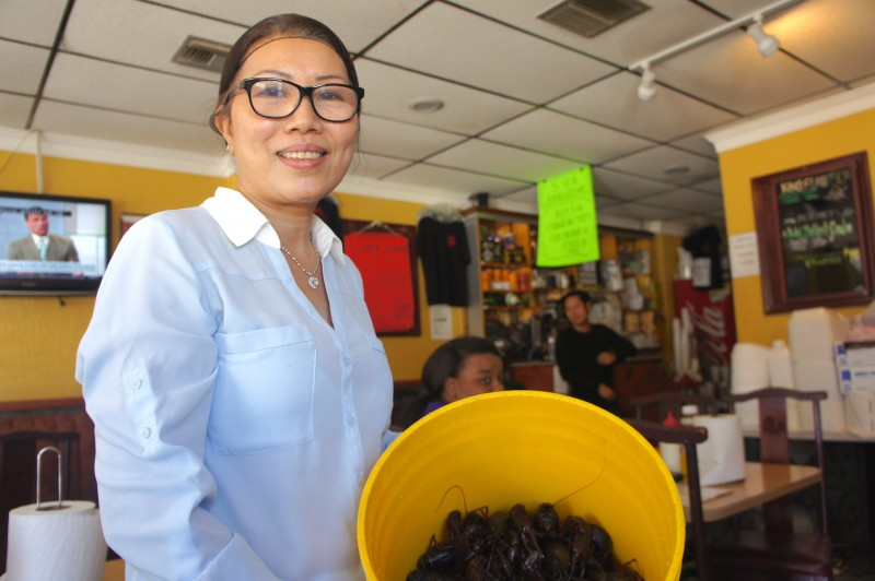 Mrs. Ha Nguyen shows off her fresh live crawfish delivered straight from Louisiana