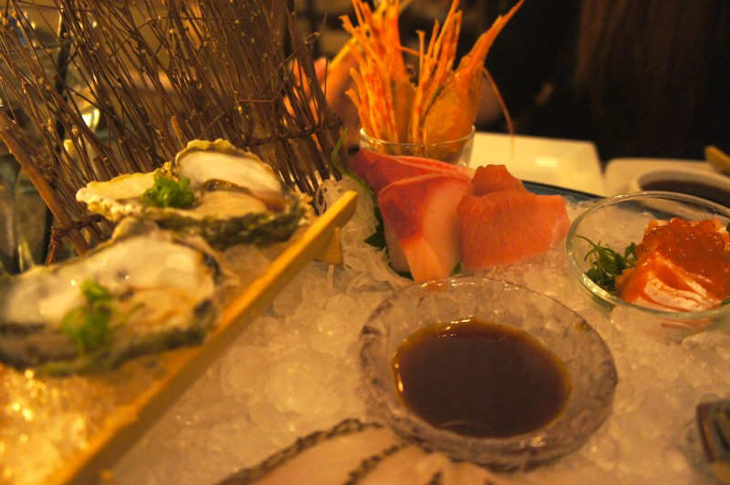 Sashimi platter at Umi with slices of tuna, snapper, oyster, and more