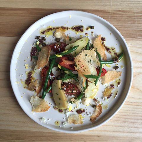 Salad Nicoise: tuna tartare, potato, pole beans, egg, garlic, black olive.