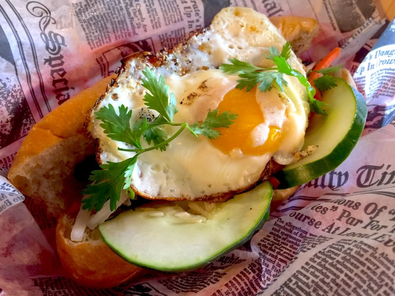 Banh mi topped with egg